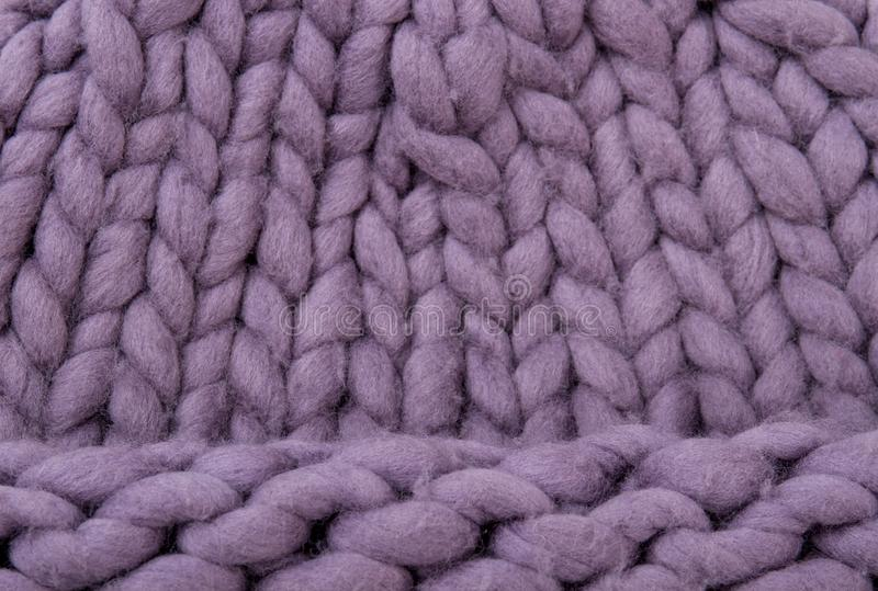 Close up female purple knitted winter hat. Merino cap background. Knitted background pattern royalty free stock photography