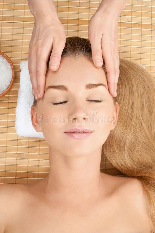 Close-up of a female receiving facial massage stock photo