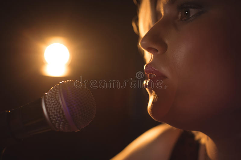 Close up of female singer. Performing in music concert stock photos