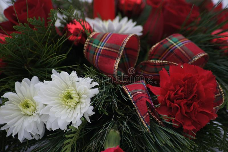 Close up of a beautiful Christmas flower arrangement. royalty free stock images
