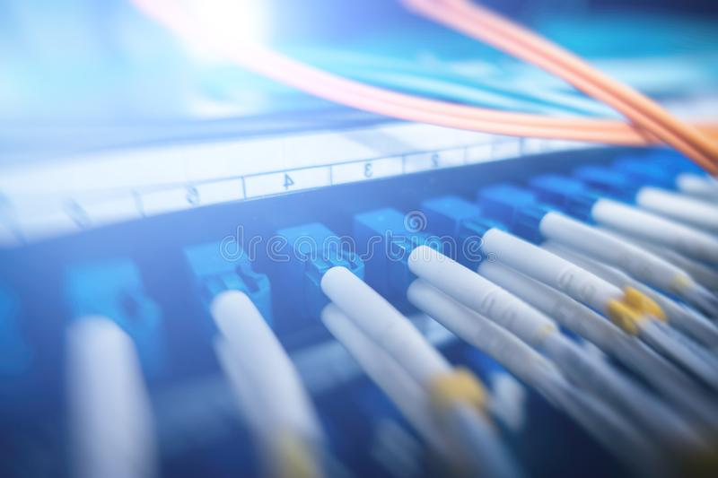 Close up fiber optic cable. Fiber optic equipment in a data center. Photo has a little noise stock image