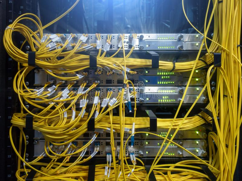 Close up fiber optic cable. Servers racks. Severs computer in a rack at the large data center. stock photos