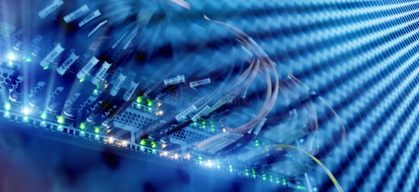 Close up fiber optic and hub in server room royalty free stock image