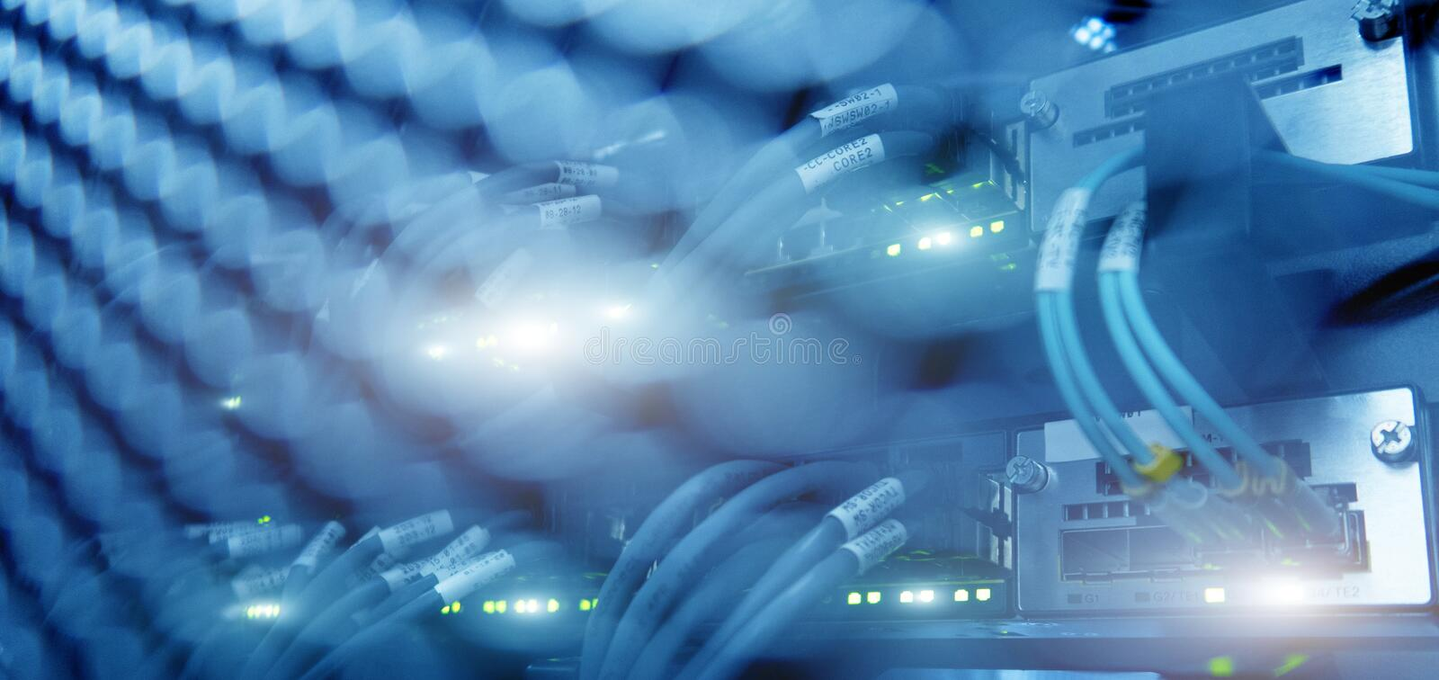 Close up fiber optic and hub in server room stock photo