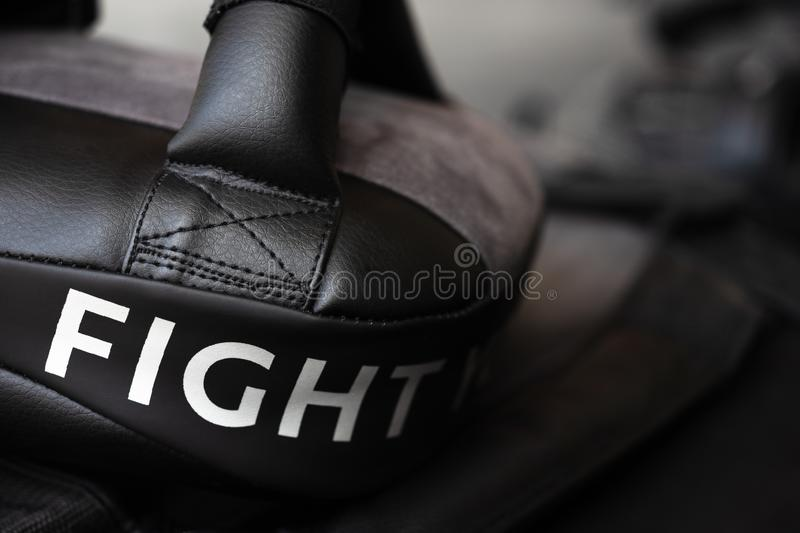 Close up of FIGHT word on black boxing and kicking practice pad stock photography