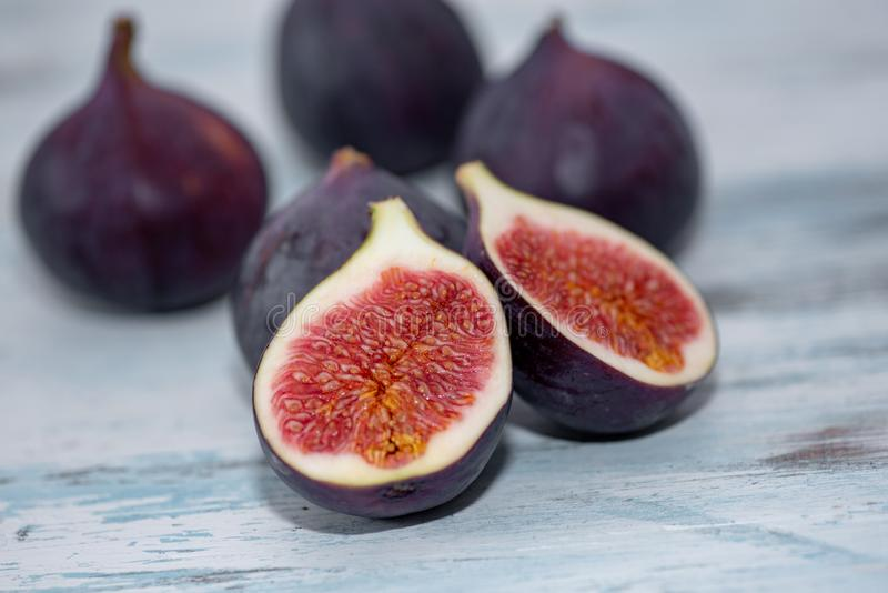 Close-up of figs on vintage wooden background. Selective focus stock photos