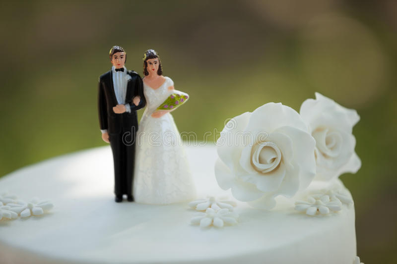 Close-up of figurine couple on wedding cake stock photos