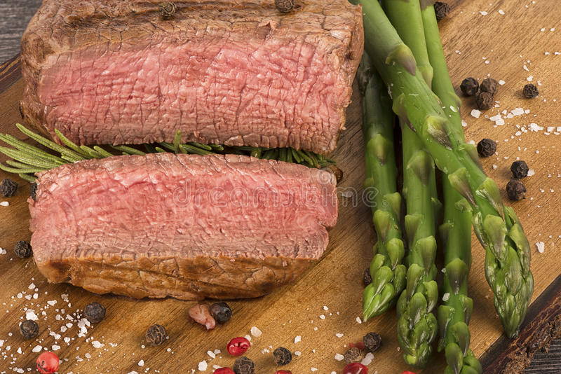 Close up on fillet mignon. With asparagus on the side royalty free stock image
