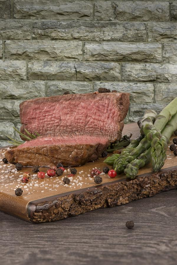 Close up on fillet mignon with asparagus on the side. stock photography
