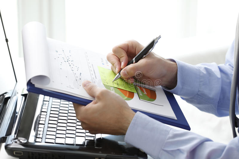 Close-up of financial advisor fill the document. Close-up of financial advisor sitting at office at fill the document. Business people royalty free stock image