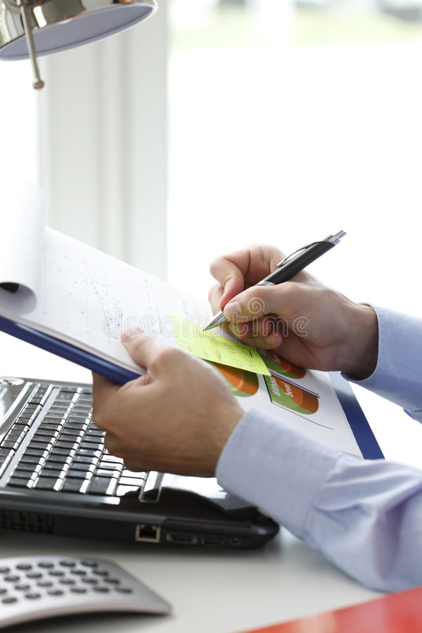 Close-up Of Financial Advisor Fill The Document Stock Photo