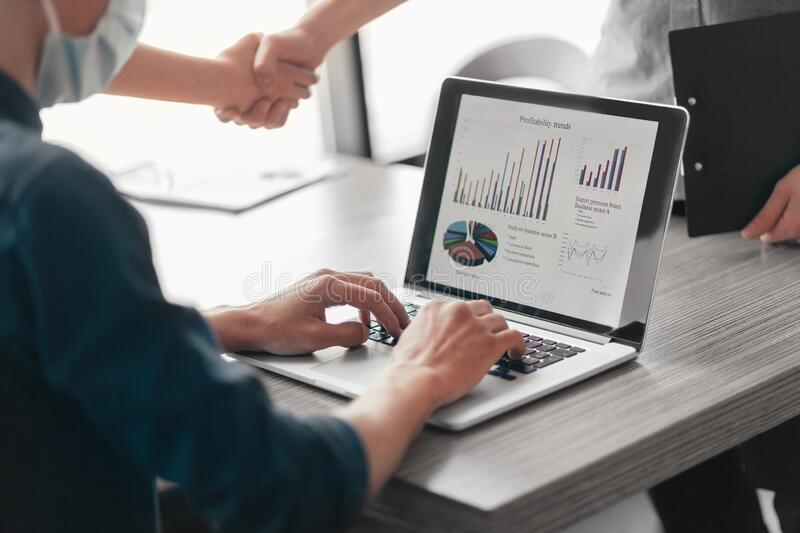 Close up. financial partners are shaking hands with each other . stock images