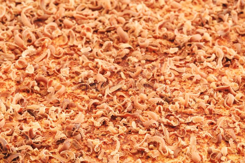 Close up of fine chocolate chips and curls chopped by hand on ca stock photos