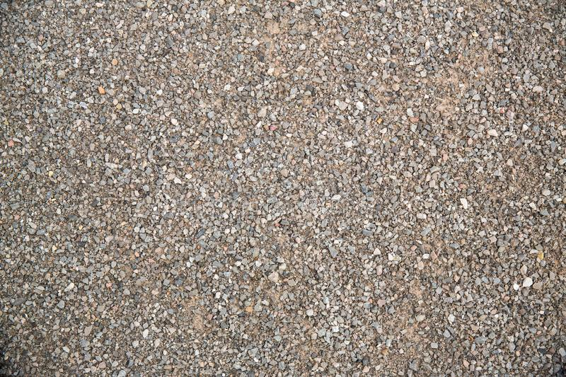 Close up fine gravel texture. gravel background, pebble wallpaper. image for background, wallpaper and copy space. Close - up Soil floor texture and seamless stock photo