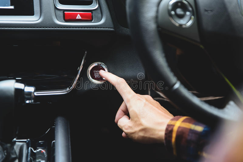 Close up Finger press button functions car engine start and stop. In motor vehicle for pre start checklist concept stock photo