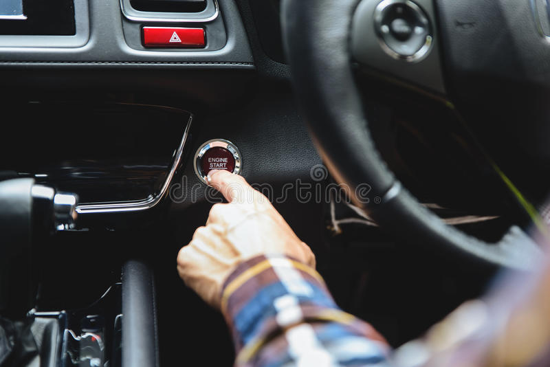 Close up Finger press button functions car engine start and stop. In motor vehicle for pre start checklist concept royalty free stock photo