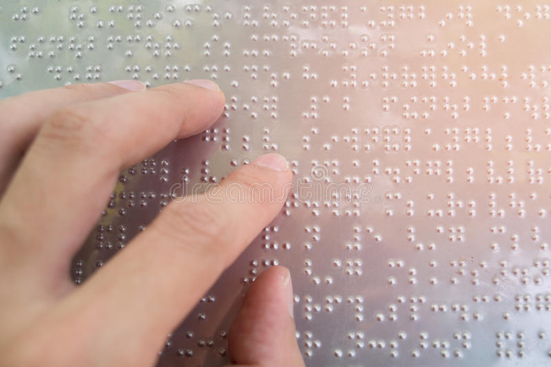 Close up finger touch to braille Code stock photos