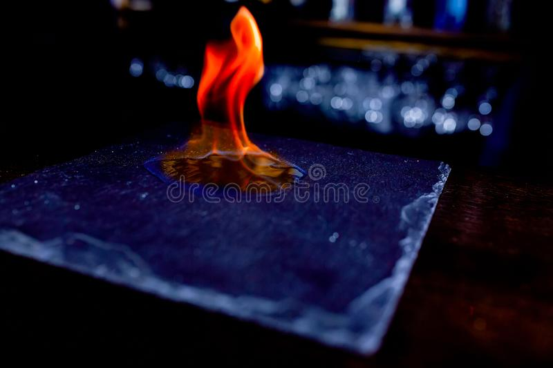 Close up of fire flames on black stone plate royalty free stock photo