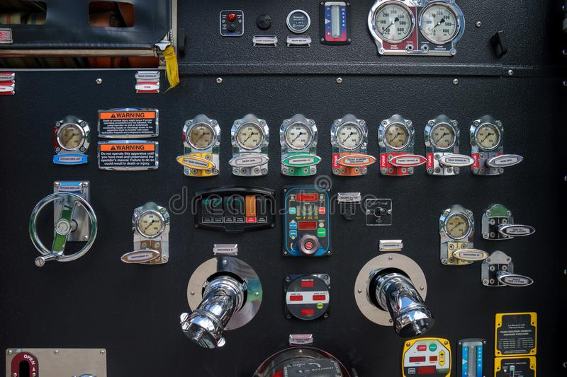 Close-up fire truck equipment detail. Fire control panel, dials and dashboard.  royalty free stock photo