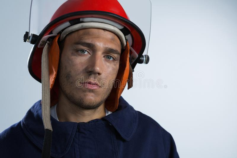 Fireman looking at camera against white background stock images