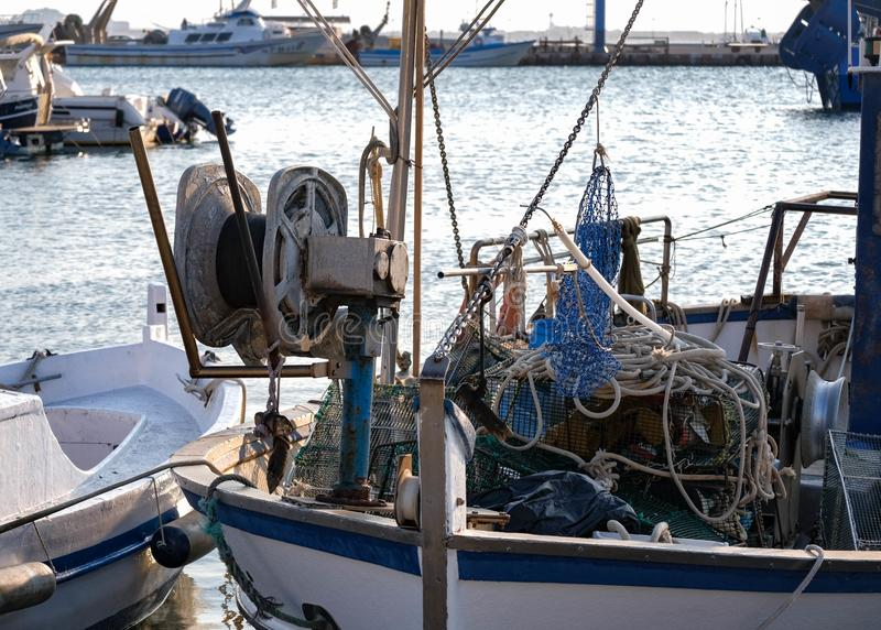 Close up of the fishing boats with marine winch, nets in the port stock image