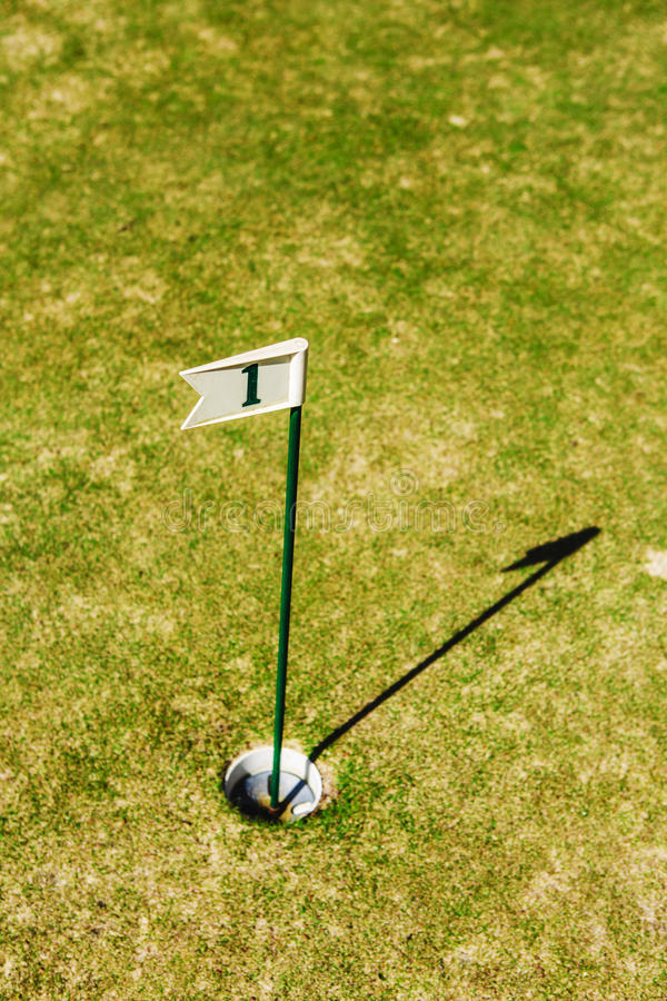 Close up of flag mark in hole on golf field stock images