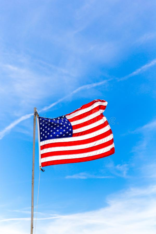 Close up Flag of United States of America waving in the wind royalty free stock photography