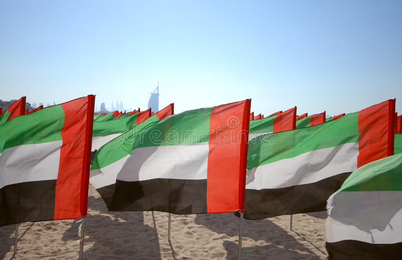Close up of flags United Arab Emirates for the anniversary celebration on the beach. UAE Natoinal day. Emirates Flag. UAE celebrates National Day on 2nd stock photography