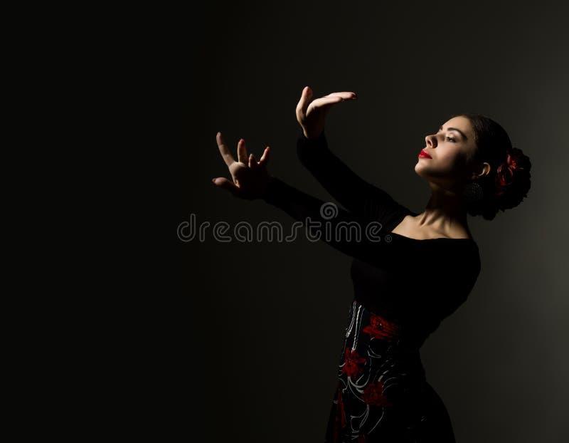 Flamenco dancer on a dark background. free space for your text. Close-up flamenco dancer on a dark background stock image
