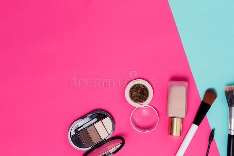 Close up of flat lay photo cosmetics, top view. Beautiful eye shadow, tone for the face, brush, glitter on the table at the makeup royalty free stock photography