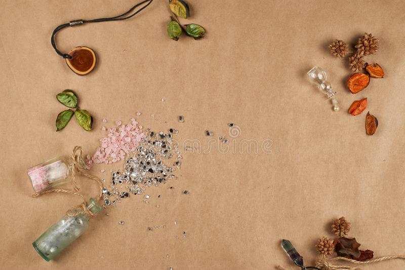 Close up flat view. cosmetic glass bottles, scattered bath salts. Place for text. royalty free stock image