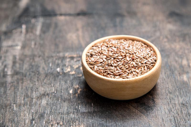 Close up of flax seeds on dark wooden background. Healthy food c stock image