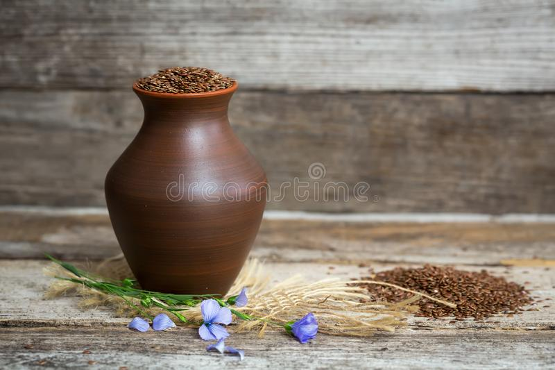 Close-up of flax seeds in a earthen jug royalty free stock images