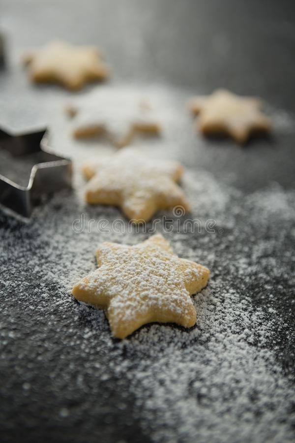 Close up of flour on star shape unbaked cookies stock image
