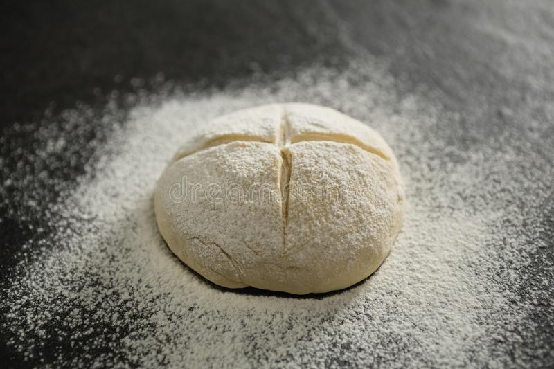 Close up of flour on unbaked bun royalty free stock images
