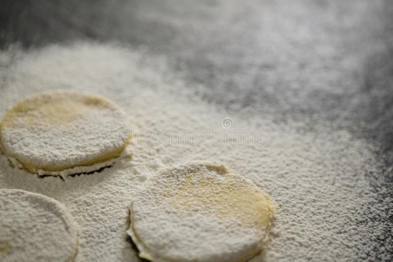 Close up of flour on unbaked cookies stock photos