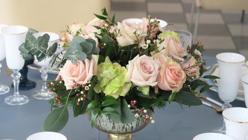Close-up of flowers on a table. Close up of pink roses on the table set up for dinner royalty free stock images