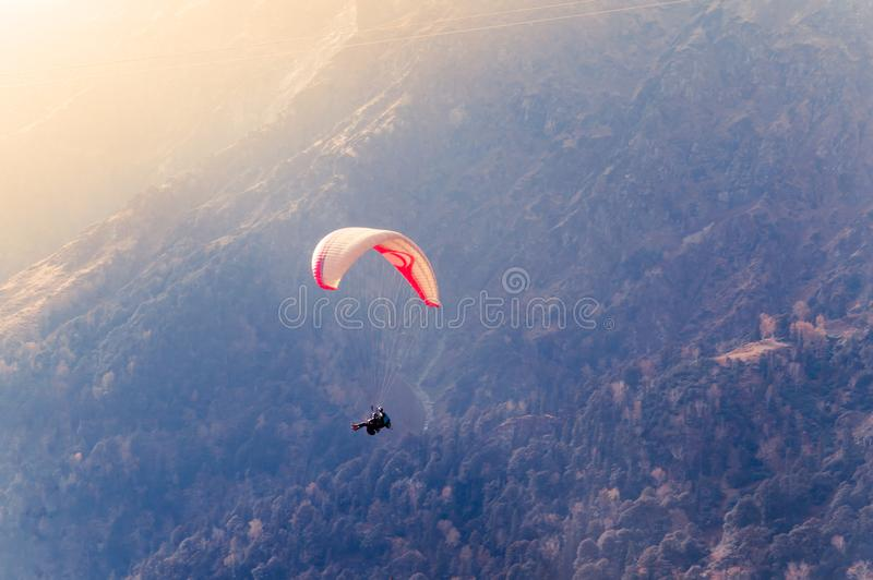 Close up of a Flying colorful parachute paragliding on beautiful mountain background. Solang Nullah, Kullu District, Manali Tehsil. Hill area, Himachal Pradesh stock photography