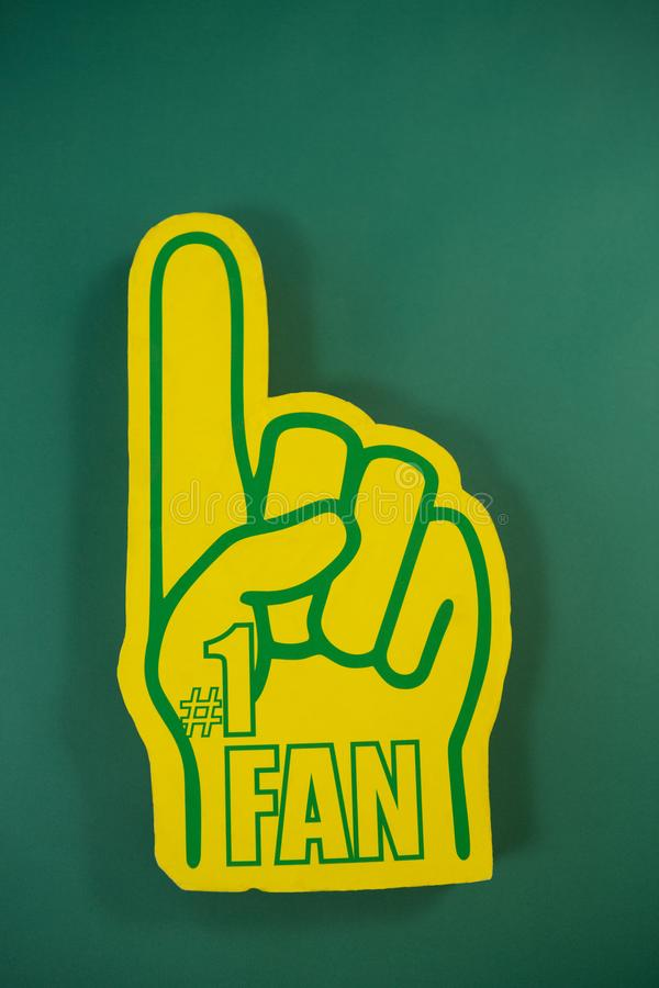 Foam hand on green background stock photography