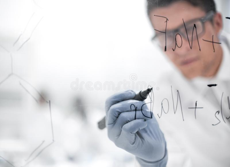 Close up.a focused scientist makes notes on the Board. Photo with copy space stock image