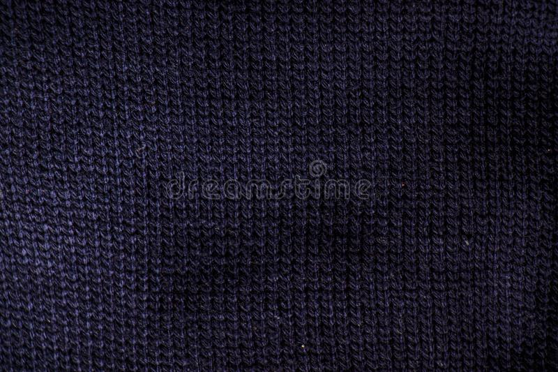 Close up of fold dark blue knit sweater fabric. Texture as background royalty free stock photography