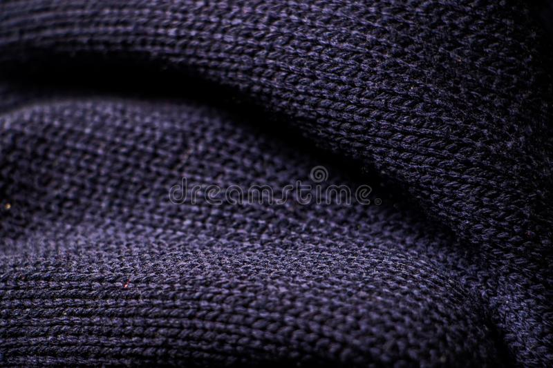 Close up of fold dark blue knit sweater fabric. Texture as background royalty free stock photos