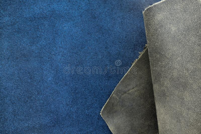 Close up fold grain grey and navy blue leather texture background,fabrics Division.  stock image