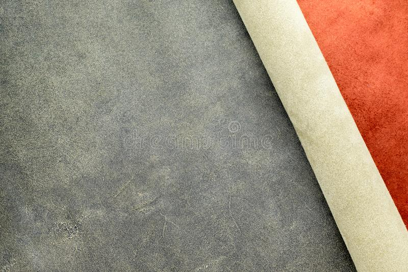 Close up fold grain grey and suede orange leather texture background,fabrics Division.  stock image