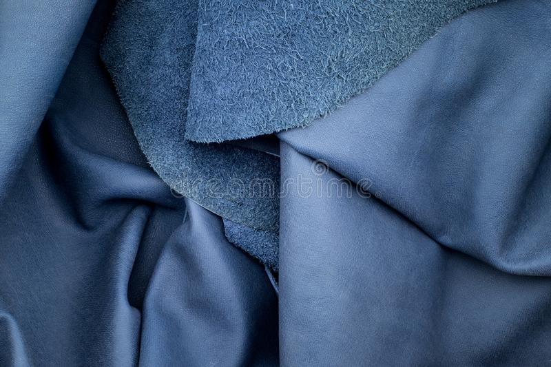 Close up fold navy blue leather texture background,fabrics Division.  stock image