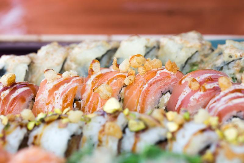 Close up food image of sushi set served on ceramic plate background. Photo for text and design elements stock photos