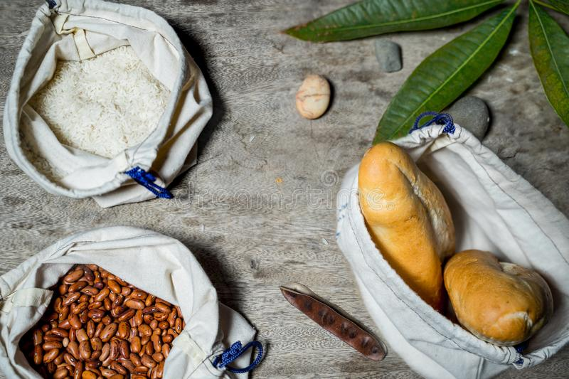 Close up of food place in non plastic bag. Bread, nonplasticbag, rice, pinuts, white, fabric, bean stock photo