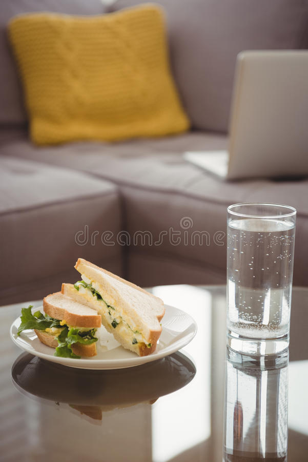Close up of food in plate by drinking glass. On table stock photos