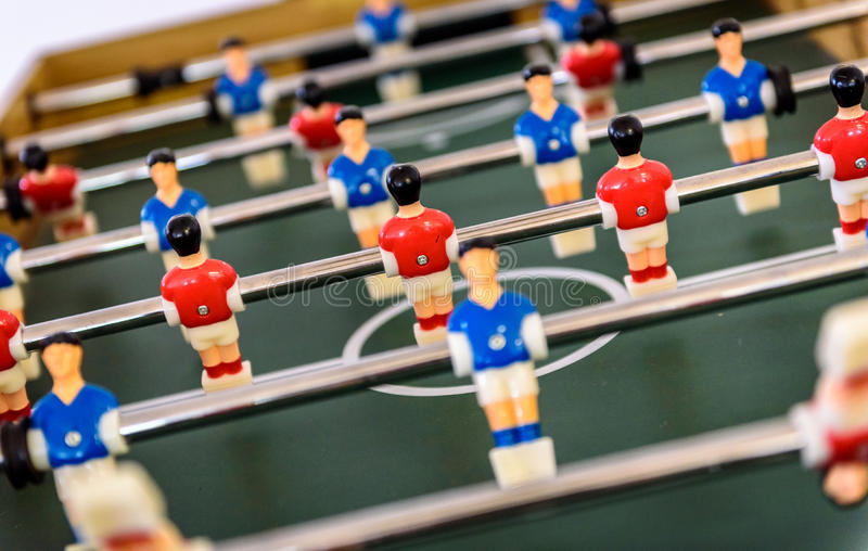 Close up of foosball Table Soccer Game match figures. Football Kicker Game with blue and red figurines royalty free stock photography