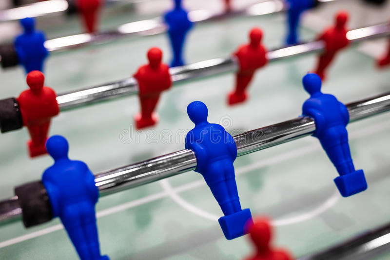 Close up of foosball Table Soccer Game. Match figures. Football Kicker Game with blue and red figurines stock image